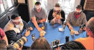 Blindfold taste testers testing the Long Islands during the first round of Long Island Iced Tea Challenge